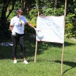 The Water Project: Bukhakunga Community, Mukomari Spring -  Facilitator Explains The Cautions Reminder Chart