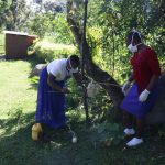 The Water Project: Bukhakunga Community, Mukomari Spring -  Facilitators Setting Up Tippy Tap