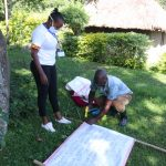 The Water Project: Bukhakunga Community, Mukomari Spring -  Improvising Stand For Setting Reminder Chart