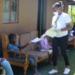 The Water Project: Bukhakunga Community, Mukomari Spring -  Issuing Handouts To Participants