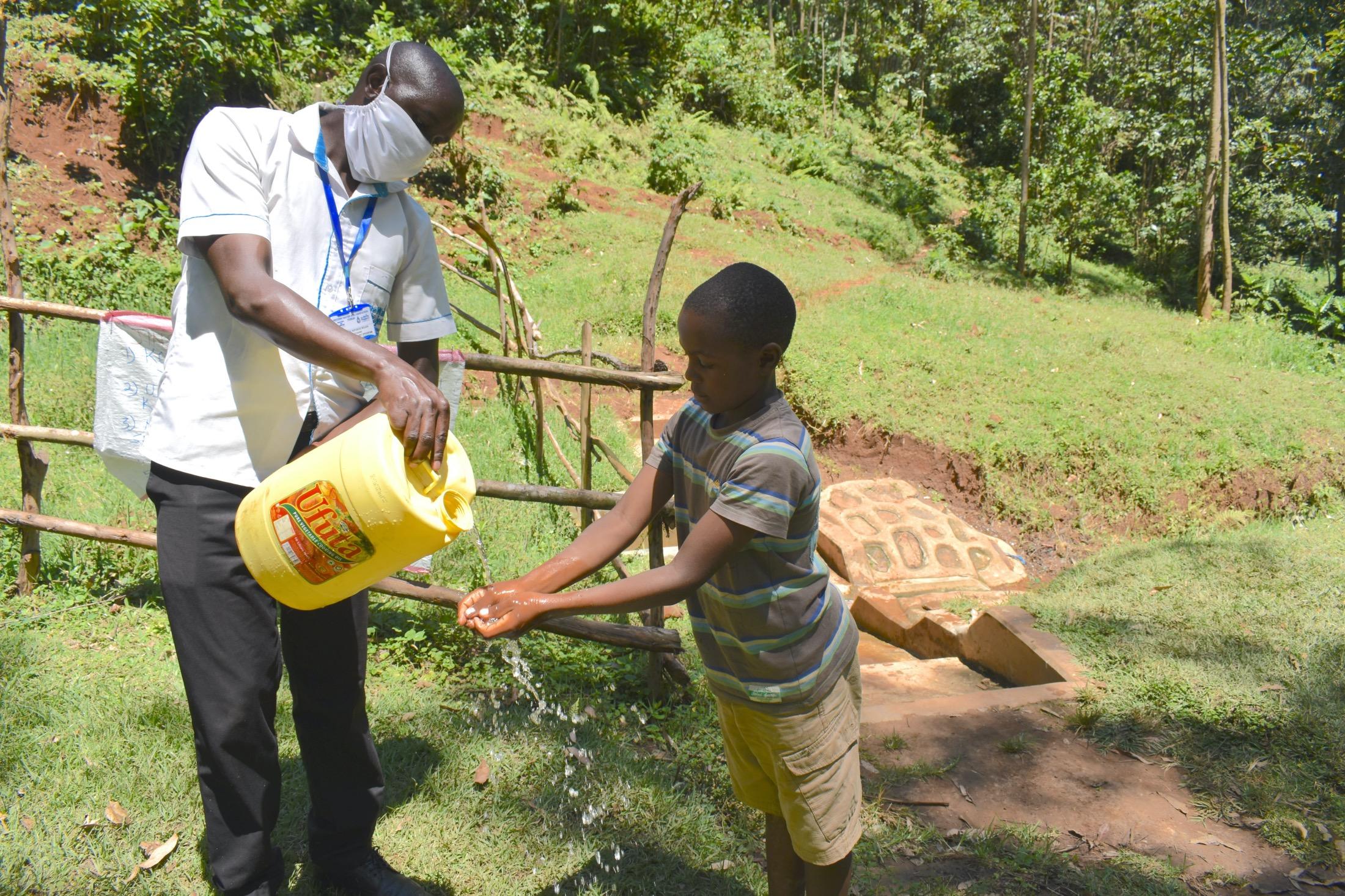 The Water Project : covid19-kenya19103-handwashing-demonstration-2