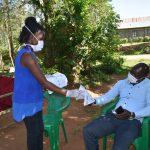 The Water Project: Musango Community, Mwichinga Spring -  Distributing Handouts