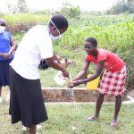 The Water Project: Mukhuyu Community, Kwawanzala Spring -  Handwashing Demonstration