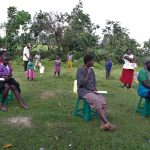 The Water Project: Mukhuyu Community, Kwakhalakayi Spring -  Community Members Litening To The Facilitator