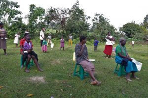 The Water Project:  Community Members Litening To The Facilitator