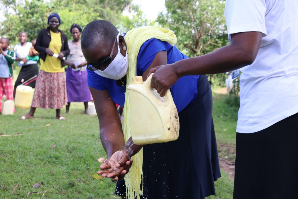 The Water Project : covid19-kenya19108-ensure-you-rinse-your-hands-using-clean-running-water