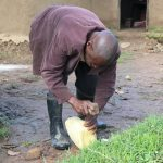 The Water Project: Mukhuyu Community, Kwakhalakayi Spring -  Sir Charles Helping Out In Making A Simple Handwashing Station