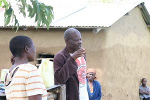 The Water Project:  Sir Charles The Chairperson Addressing The Community Members