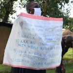 The Water Project: Mukhuyu Community, Kwakhalakayi Spring -  The Facilitator Holding Up The Chart