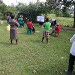 The Water Project: Mukhuyu Community, Kwakhalakayi Spring -  The Facilitator Using The Chart To Teach