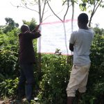 The Water Project: Mukhuyu Community, Kwakhalakayi Spring -  Two Community Members Mounting The Chart