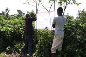 The Water Project:  Two Community Members Mounting The Chart