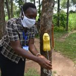 The Water Project: Burachu B Community, Namukhuvichi Spring -  A Functional Leaky Tin Used During Handwashing Demonstration