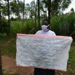 The Water Project: Burachu B Community, Namukhuvichi Spring -  Holding The Prevention Redminders Chart