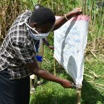 The Water Project: Burachu B Community, Namukhuvichi Spring -  Nailing The Chart Onto Support Poles