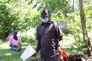The Water Project:  A Community Health Volunteer Showcasing Wrong Ways Of Wearing Masks