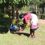 The Water Project: Kambiri Community, Sachita Spring -  Demonstrating Use Of A Leaky Tin