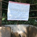The Water Project: Kambiri Community, Sachita Spring -  Installed Reminder Chart At The Spring