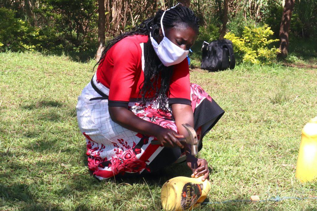 The Water Project : covid19-kenya19119-using-local-materials-to-make-a-handwashing-station