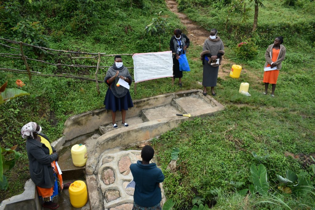 The Water Project : covid19-kenya19126-ms-chelagat-addressing-the-community-members