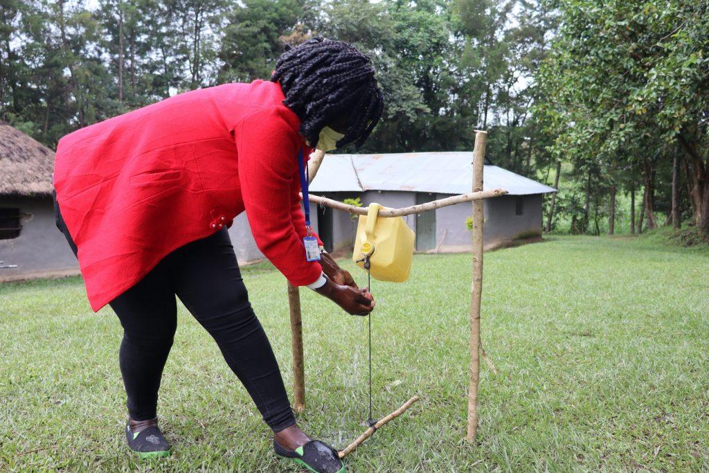 The Water Project : covid19-kenya19128-using-a-hands-free-handwashing-station