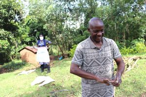 The Water Project:  Community Elder Leading Handwashing Training