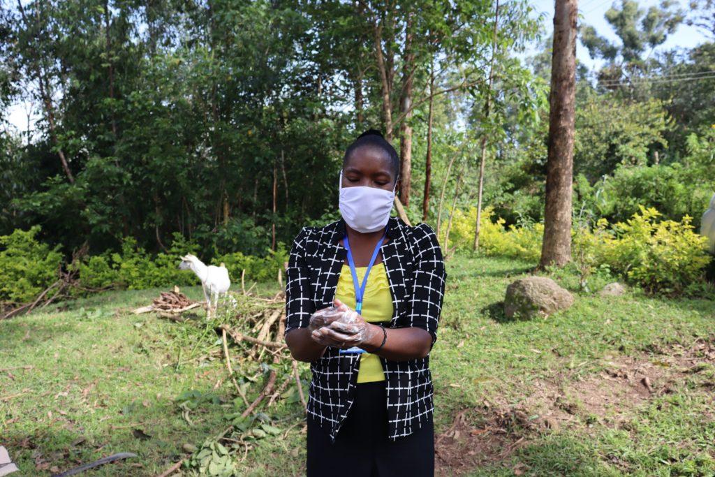 The Water Project : covid19-kenya19131-masinde-conducting-sensitization-on-covid