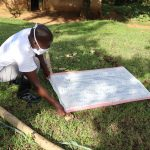 The Water Project: Mubinga Community, Mulutondo Spring -  Mr Alemo Mounting The Chart Onto The Support Poles