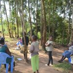 The Water Project: Maondo Community, Ambundo Spring -  Community Members Listening In To Ms Shigali