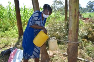 The Water Project:  Ms Shigali Filling The Handwashing Station With Water