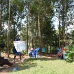 The Water Project: Maondo Community, Ambundo Spring -  Ms Shigali Holding Up The Teaching Aid