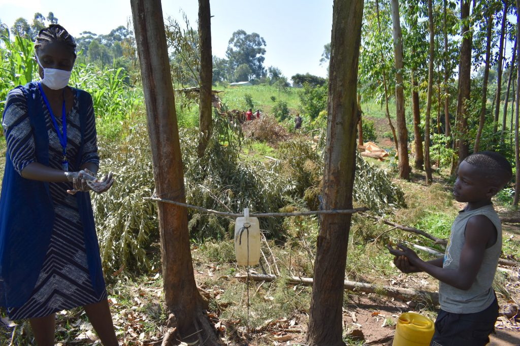 The Water Project : covid19-kenya19134-the-facilitator-leading-a-handwashing-demonstration