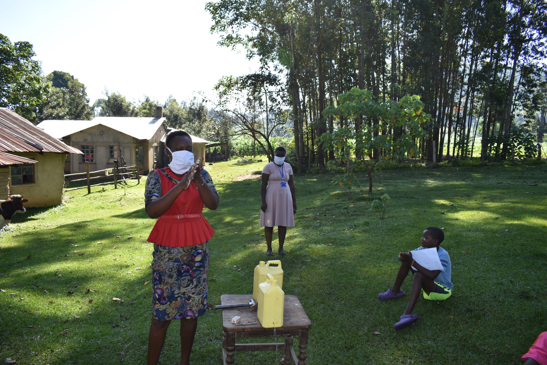 The Water Project : covid19-kenya19136-handwashing-with-soap-and-water-is-essential-to-keep-virus-away