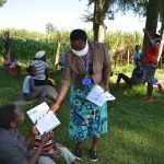 The Water Project: Malimali Community, Shamala Spring -  Issuing Handouts To Participants