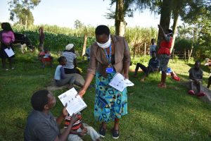 The Water Project:  Issuing Handouts To Participants