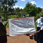 The Water Project: Lutonyi Community, Lutomia Spring -  The Facilitators Holding Up The Chart