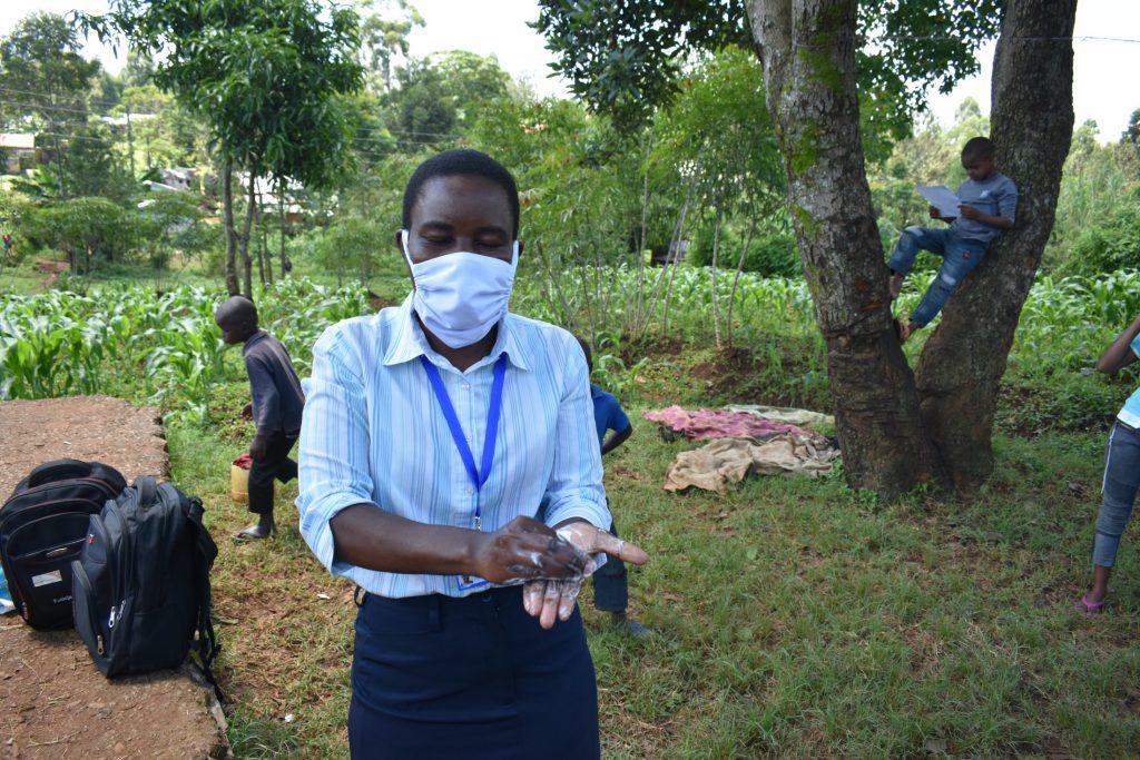 The Water Project : covid19-kenya19138-teaching-the-ten-steps-of-handwashing