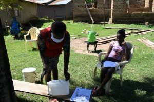 The Water Project:  Demonstration Of Making A Leaky Tin Handwashing Station