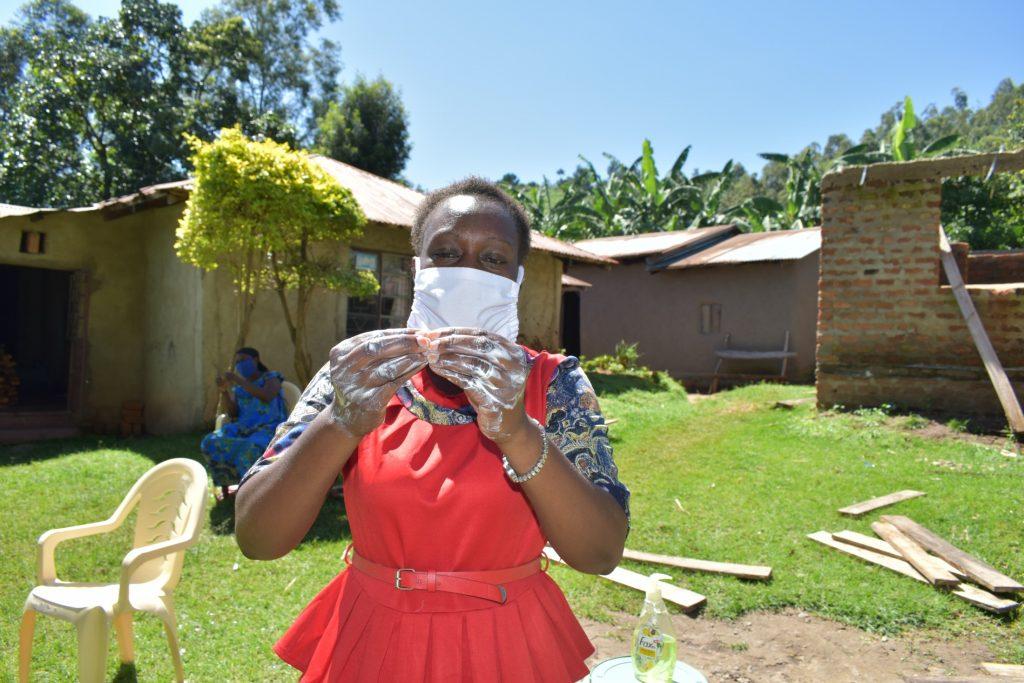 The Water Project : covid19-kenya19143-facilitator-karen-demonstrates-handwashing