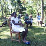 The Water Project: Buyangu Community, Mukhola Spring -  Community Members Following Ten Steps Of Handwashing