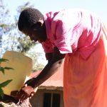 The Water Project: Buyangu Community, Mukhola Spring -  Washing Hqnds At The Newly Installed Handwashing Point