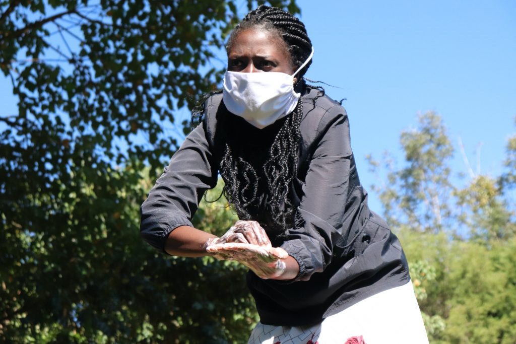 The Water Project : covid19-kenya19148-demonstrating-ten-handwashing-steps