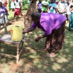 The Water Project: Shisere Community, Richard Okanga Spring -  Using A Locally Made Leaky Tin Handwashing Stations