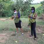 The Water Project: Emurumba Community, Makokha Spring -  Homemade Mask Demonstration