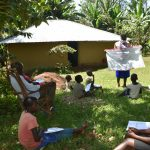 The Water Project: Ebutindi Community, Tondolo Spring -  Use Of Charts With Corona Cautions At The Training