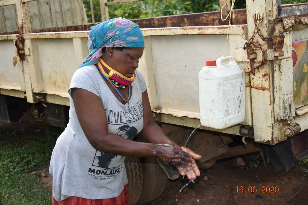 The Water Project : covid19-kenya19183-margaret-mbone-at-her-hand-washing-station