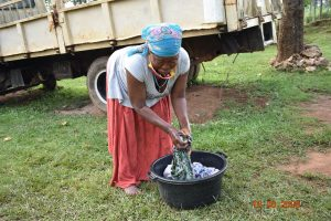 The Water Project:  Margaret Mbone Doing Her Laundry With Water From Kubai Spring