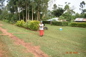 The Water Project:  Margaret Mbone Outside Her Home