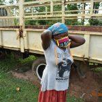 The Water Project: Sichinji Community, Kubai Spring -  Margaret Mbone Puts On Her Mask