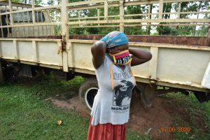 The Water Project:  Margaret Mbone Puts On Her Mask